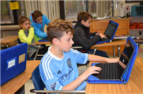 Chromebooks foster independence at Prodell Middle School photo